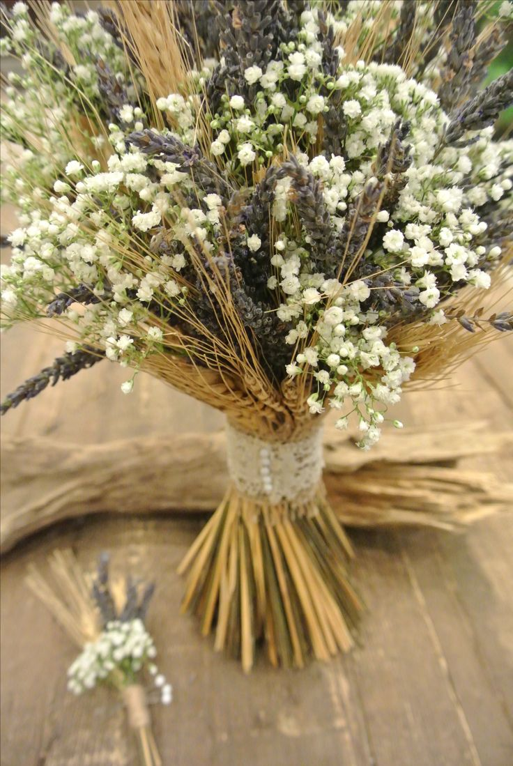 Rustic bridal bouquet with wheat, lavender and baby's breath. Designed by Forget-Me-Not Flowers.