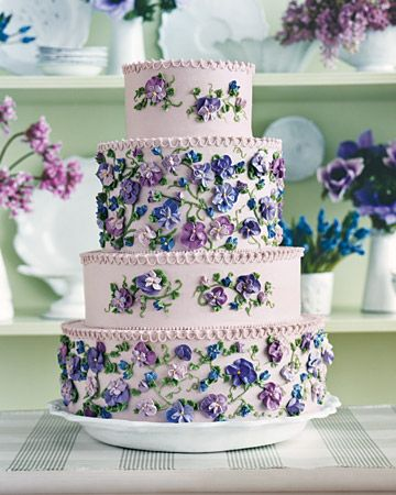 A lilac four-tier cake piped with pretty violets - not that I'm nearly good enough to pull this off...