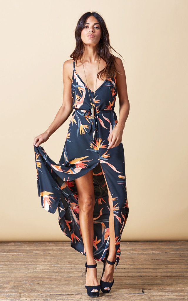 Maxi dress with split to front, dipped back and tie waist. Dress up with heels for an evening out or go barefoot for an elegant boho daytime look! A great summer wardrobe staple.
