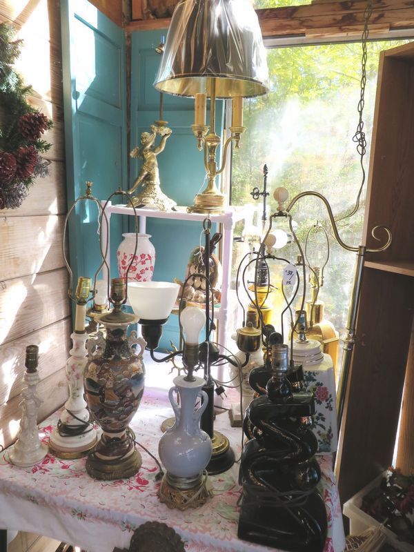 8 working lamps including hand painted Asian lamp, converted oil lamp, blue ceramic, seashell ship lamp, floor lamp base, 3 arm brass desk lamp, black art deco lamps, one not working.
