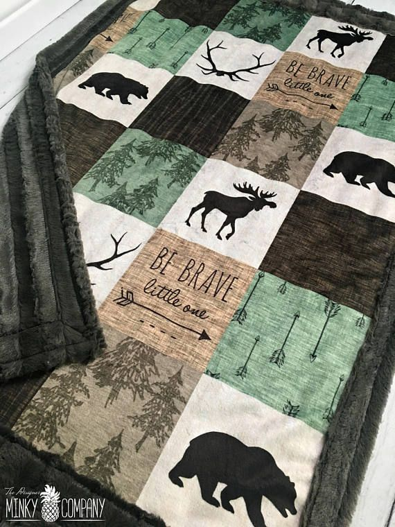 This blanket has minky on both sides. The front side is our Rustic Be Brave Little One Faux Quilt designer minky, and the back and boarder are our pewter velvet minky. ***The front is one solid piece of minky that has not been cut or quilted.*** ●▬▬▬▬▬▬▬♥ Size and Fabric