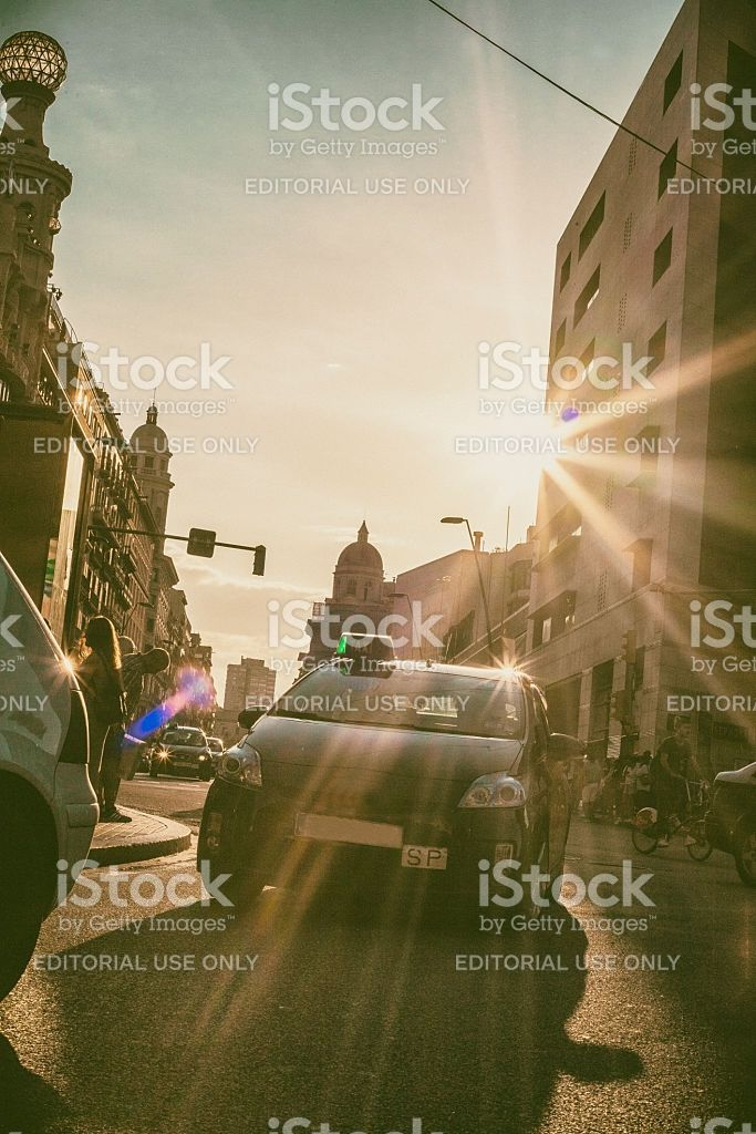 Taxi car goes by the street in Barcelona City royalty-free stock photo