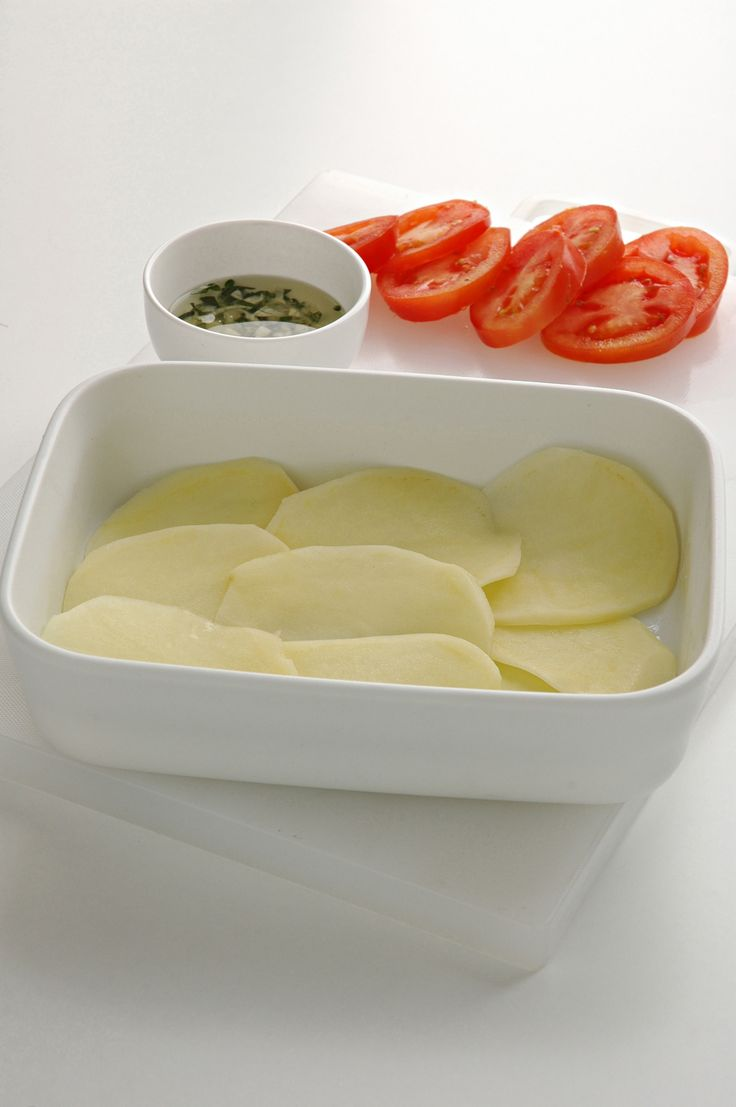 Patate e pomodori gratinati al forno