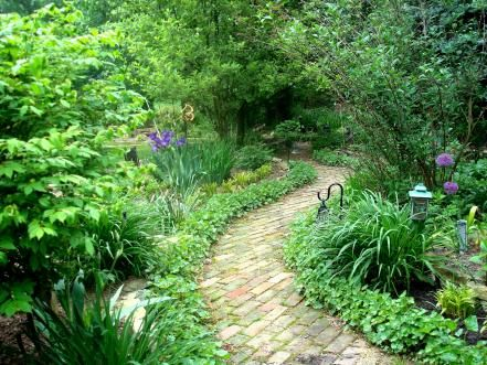 A curvy brick pathway leads to a calm, abundant garden. HGTV fan JackL lined the pathway with coral bells for a relaxing, eye-pleasing stroll through the garden. A few lanterns along the way add subtle lighting.
