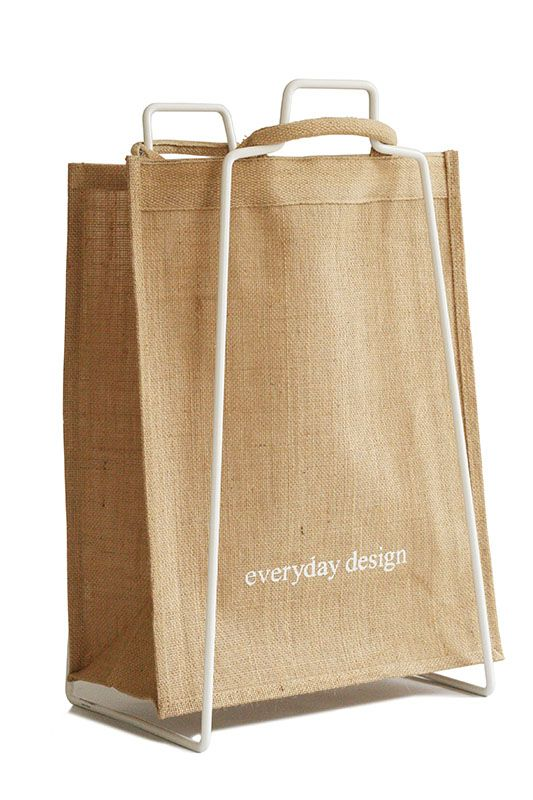 A Helsinki paper bag holder with an Everyday jute bag. Design by Helena Mattila. The Helsinki paper bag holder is made in Finland.