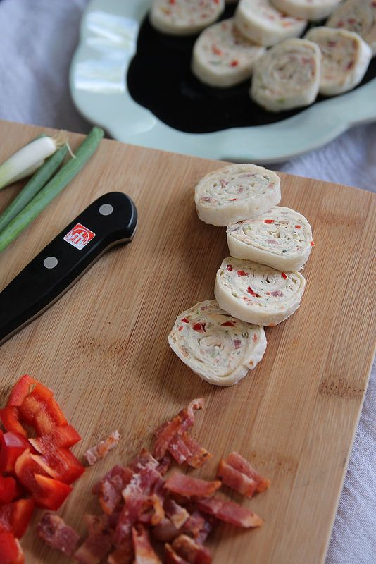 Bacon Ranch Cream Cheese Roll-Ups: Cream cheese, red peppers, scallions, ranch dressing mix and bacon make these roll-ups the perfect appetizer for a crowd.