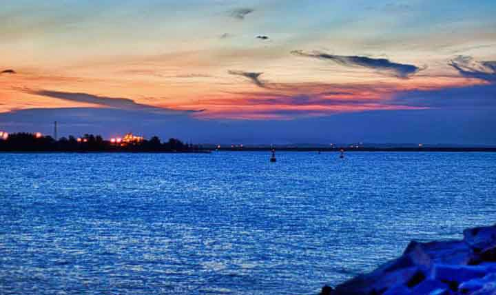 A swirl of colours creates a magnificent sunset scape over the Richards Bay Harbour. Thank you Nobby Natalie Clarke for this image. For more visit  www.greatestsunsets.com