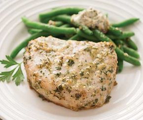 Thick pork loin chops encrusted with a sweet spinach and herb rub. #ThanksgivingRecipes #tastefullysimple #TSbyJacki