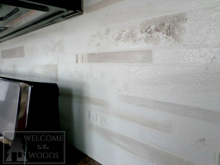 Close-up of faux marble tile painted on a kitchen back splash to look real! This complete photo tutorial will show you how to diy!
