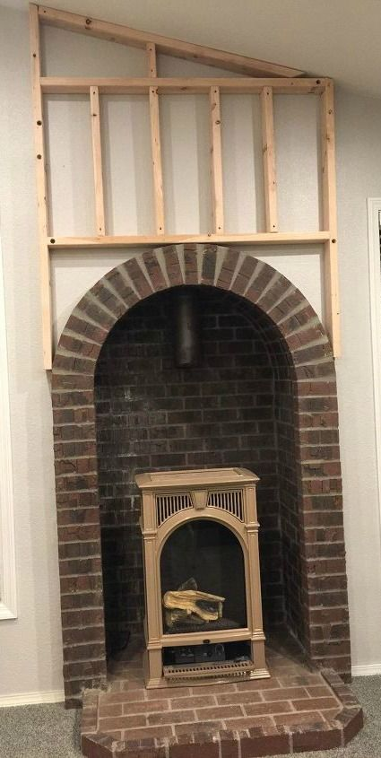 A woman nails blonde boards to the wall, and a few steps later...THIS fireplace idea is amazing!