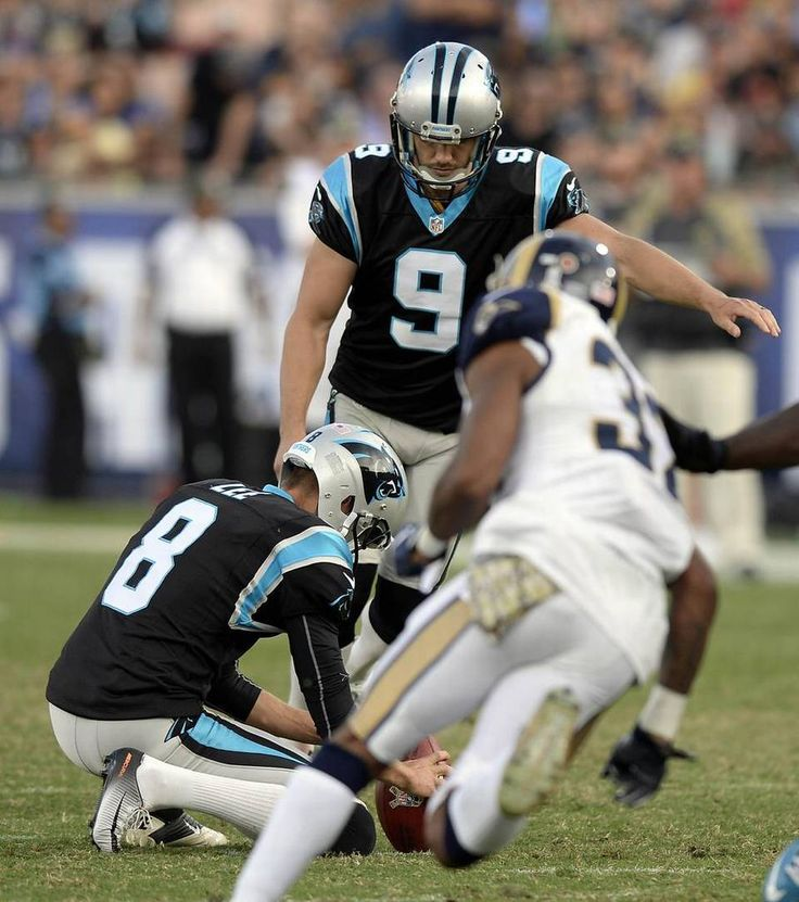 Panthers vs. Rams:  13-10, Panthers  -     Carolina Panthers kicker Graham Gano (9) attempts a field goal as punter Andy Lee (8) holds, against the Los Angeles Rams, in the second half at Los Angeles Memorial Coliseum in Los Angeles, CA on Sunday, November 6, 2016. The Panthers won, 13-10.