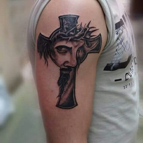Jesus with cross tattoo