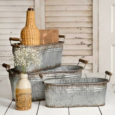 Rustic Baskets with Wood Handles - Set of 3 - Our set of three Rustic Baskets is perfect for storage and organization. You'll love them in anyroom. The baskets nest for easy storage.