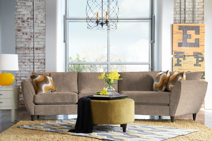 La-Z-Boy Tribeca Sectional Sofa | Flared arms and tapered legs give this sectional a unique look. Plus, PIN TO WIN an ottoman! Get contest details at http://houseandhome.com/la-z-boy | #LaZBoy #Sectional #Sofa #LivingRoom #Furniture