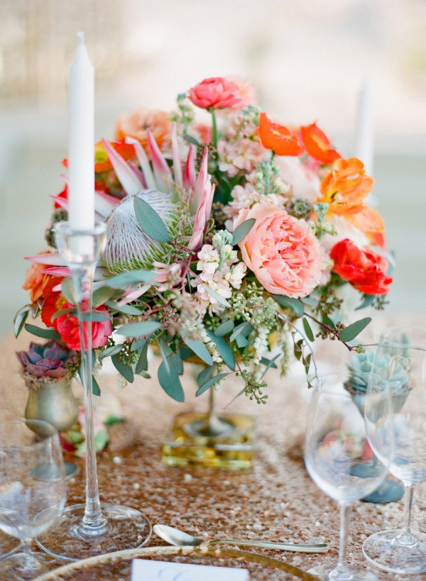bright red, pink and orange centerpiece with king protea