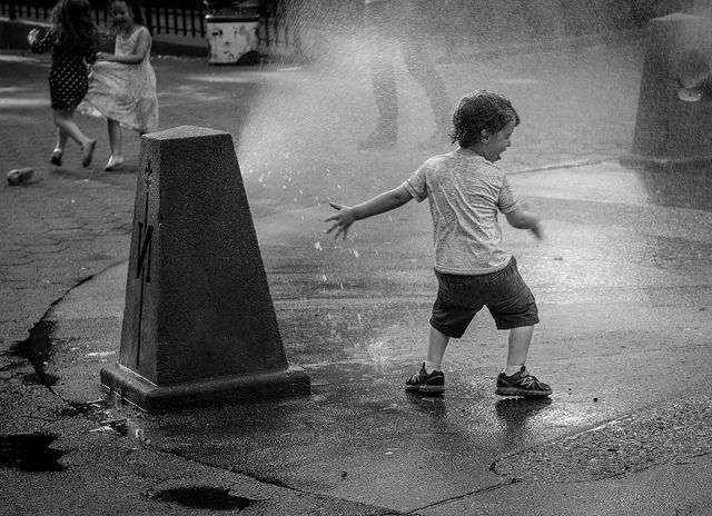 Summer by Ann on Flickr. When the NYC public parks turns on the water spouts to cool off the little tykes!