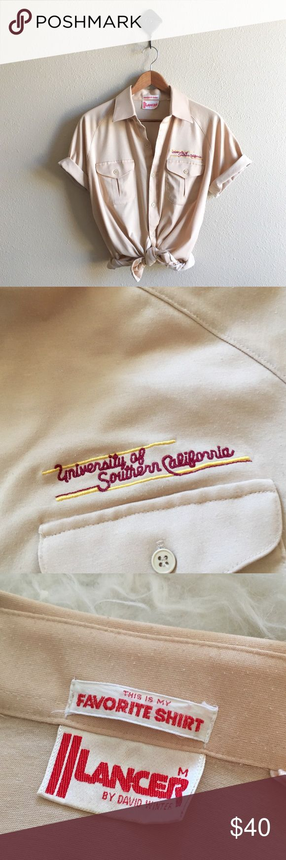 '70s / USC Polo Shirt Classic retro polo tee with USC embroidery. Unisex, fits men's small or women's for the oversized look. Check measurements. Excellent vintage condition!  BRAND: Lancer by David Winter MATERIAL: cotton / poly YEAR/ERA: 70s LABEL SIZE: M BEST FIT: M  MEASUREMENTS: Chest 20 inches Length 27 inches  ☒ I do not model or trade, sorry! ❁ Check out my closet for more vintage! Vintage Tops Button Down Shirts