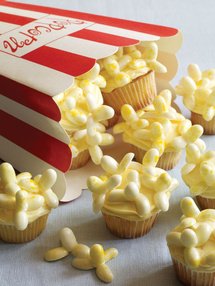 "Celebrate the ""big screen"" with this clever recipe featuring our blockbuster flavor, Buttered Popcorn. The cupcakes feature ""popcorn kernels"" made from the famous savory jelly bean.  Credit: whatsnewcupcake (Karen Tack and Alan Richardson, authors of Hello, Cupcake!)"