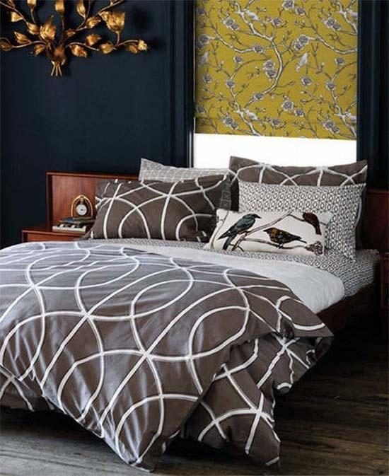 Dwell Bedding. Love this pattern. Chandelier, Bluish wall and the window cover in yellow, masculine room