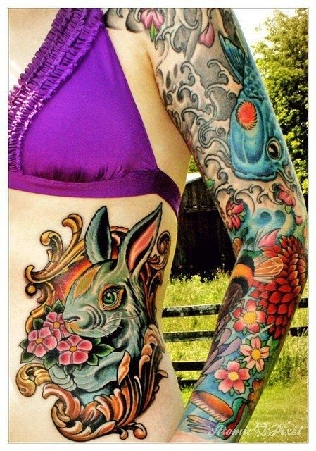 Rabbit tattoo, koi and flowers. Amazing colors.