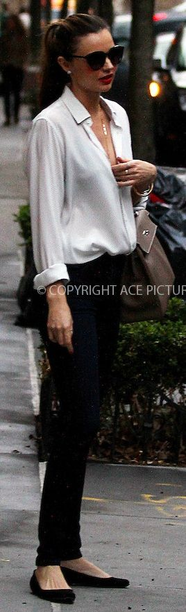CLASSIC BLACK AND WHITE. THE WHITE SHIRT WITH PERFECT SKINNY PANT. Miranda Kerr
