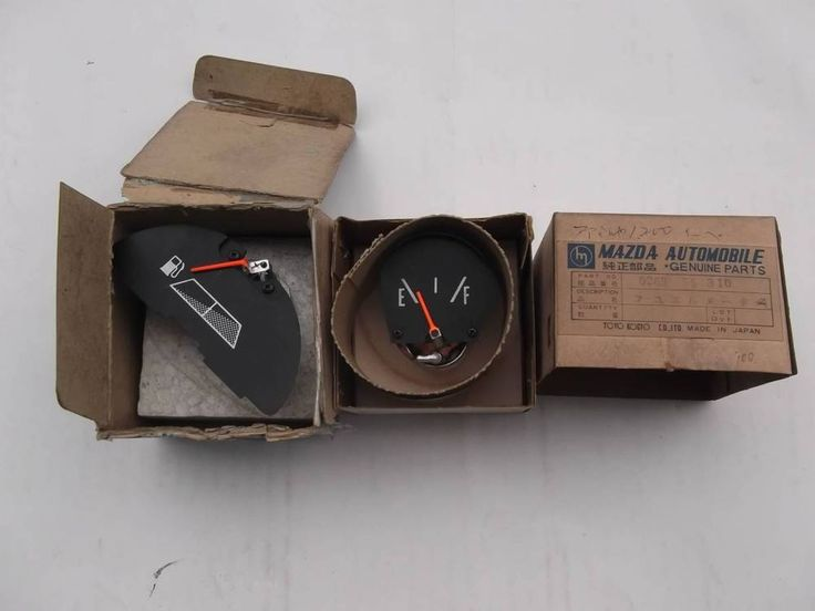 Old Mazda Familia Fuel Gauges,  One with part No, and one without the part no.  #Mazda