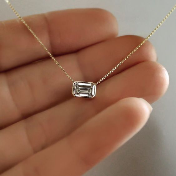 rubies.work/… 14k Gold .80 carat Emerald Cut Diamond Necklace by cestsla on Etsy