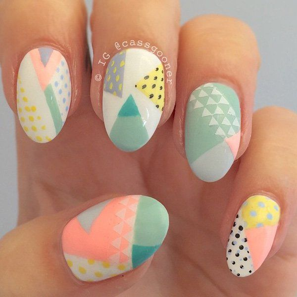 Are you a fan of polka dots and patterns? This abstract nail art design makes good use of interesting patterns combined with pretty pastel polishes in contrast with black and white colors.