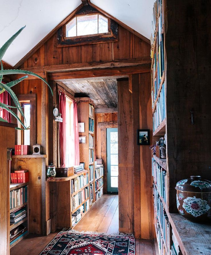 """""""The hallway/library as it's been for decades at the @deslindseya and @homestead_custom_sawmilling home. : @katalves"""""""