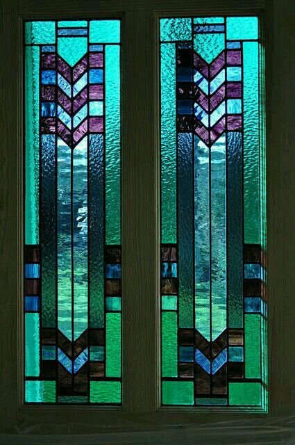 Art Deco chevron stained glass doors. - Photo by John  Hardisty