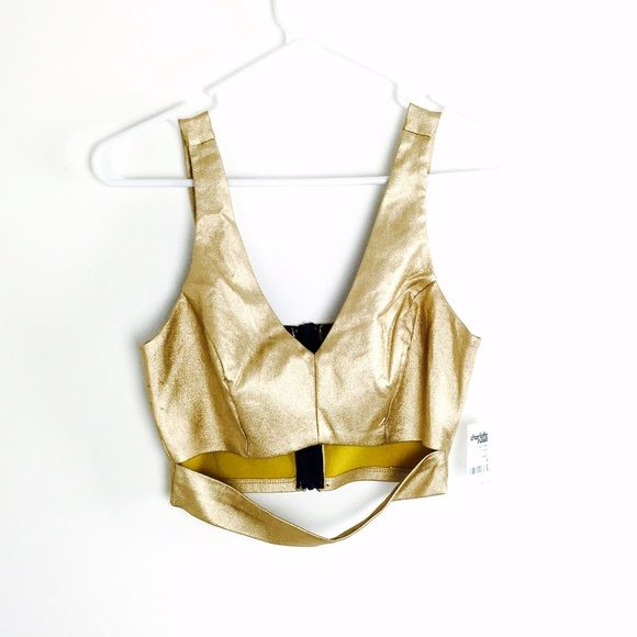 Gold metallic crop top with cut out Pretty gold metallic crop top! Has a minor manufacturer defect as seen in pic 3, but unnoticeable! This top has never been worn, still has tags! price firm for this item. Tops Crop Tops