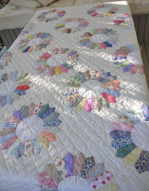 All Dresden Plates are machine pieced and hand appliqued. Hand quilted. A beauty.