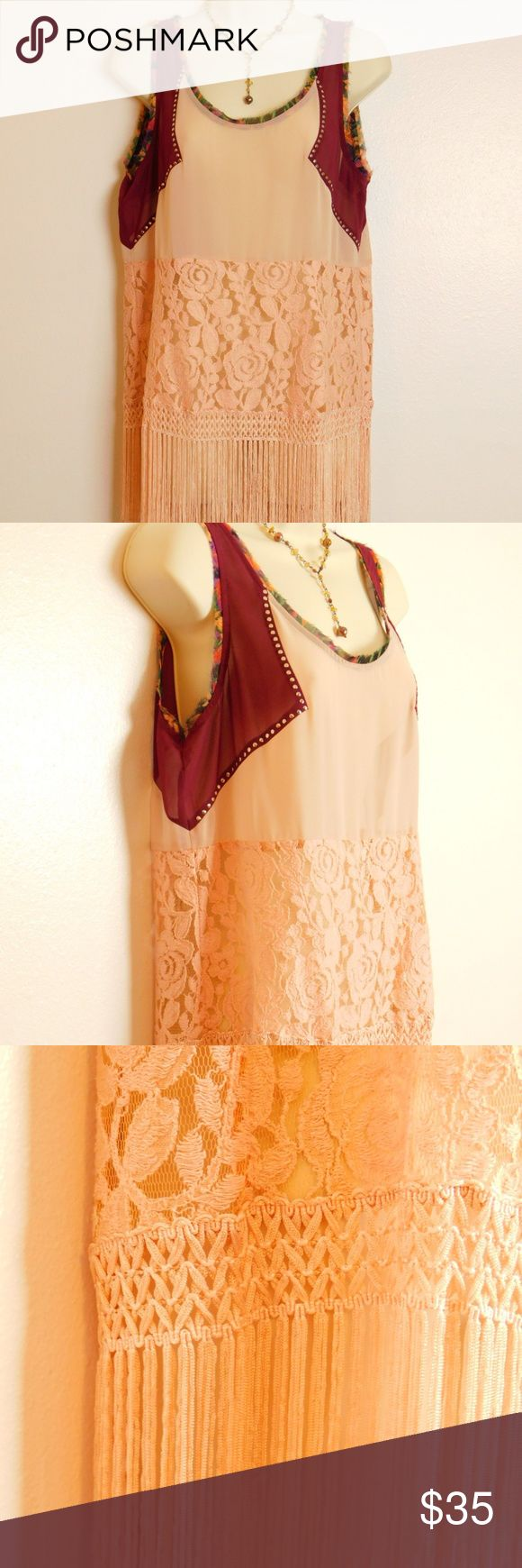 """Buckle Lace Fringe Studded Chiffon Boho Blouse M """"Gimmicks by BKE Buckle"""" embellished boho fringed hem blouse Women's size Medium M(8/10) Color:  Peach Burgundy Orange Green Length 28"""" shoulder to fringe hem, Bust 19"""" across EUC excellent pre-owned conditions, LOOKS ALMOST NEW  Pullover with scoop neckline Keyhole with single button closure at neck Silver studded chiffon bodice applique Lace panel with fringed hem Not lined  Fabric & Care Self 100% polyester Contrast 60% cotton, 40% rayon…"""