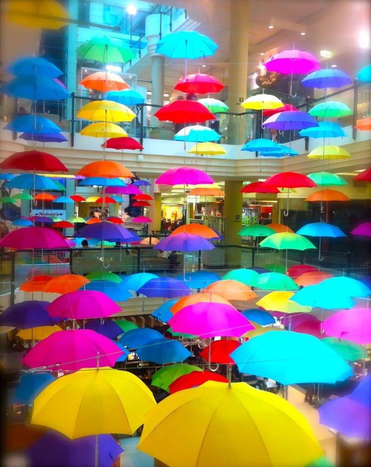 Sea of rainbow umbrellas