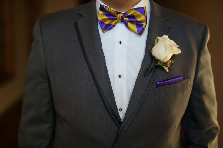 Idea for the groom's attire:  gray suit, white boutonniere, and purple + yellow bow tie.  Fun and unique!