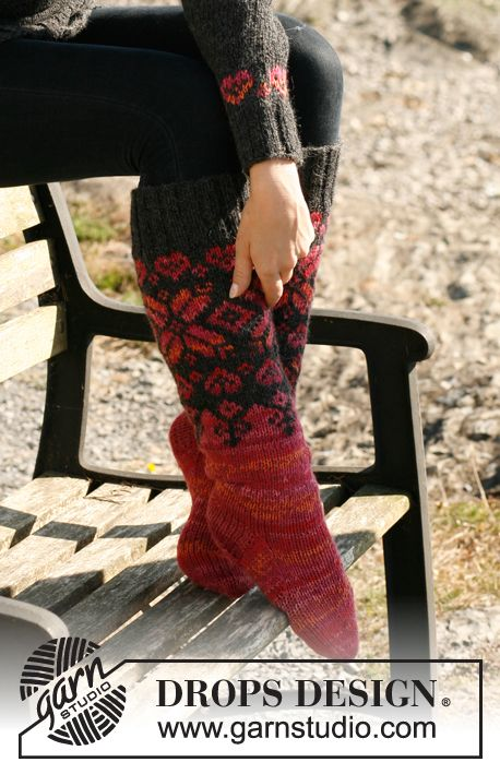 Knitted DROPS socks with Norwegian pattern in Nepal, Alpaca and Fabel.   Free pattern by DROPS Design.