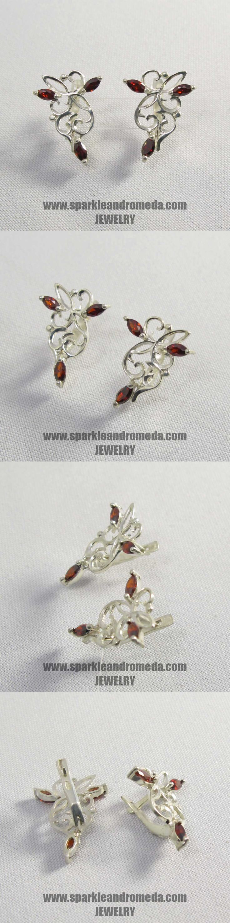 Sterling 925 silver earrings with 6 marquise 5×2,5 mm red almandine color cubic zirconia gemstones.