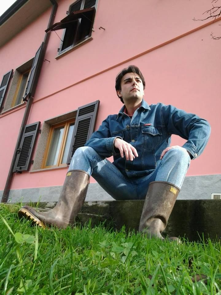 Does this guy know how cool he looks in his double denim outfit tucked into a pair of brown wellies?