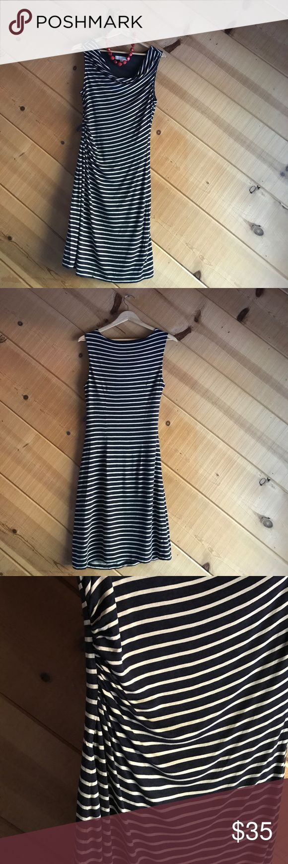Striped Party Dress This form fitting navy blue and white striped dress is for going out! Pairs great with accent accessories like a chunky red necklace (not included) and red heels. Gathered on the right hip which gives a nice bit of cover for the tummy. Length hits at the knee. Pre worn great condition. LOFT Dresses Midi