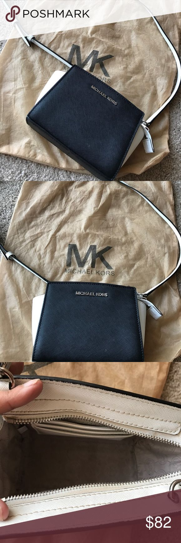 Michael Kors bag Price is firm. Michael Kors Mini Selma bag. Black and white. Comes with long strap as well as dust bag. Good condition. I'm just looking for a larger sized Selma now. Michael Kors Bags Crossbody Bags