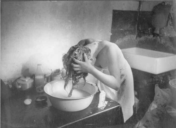 Hair Wash, 1948. Bert Hardy  .....   and I still do this... when I'm too lazy or it's to cold to get in the shower in the morning...