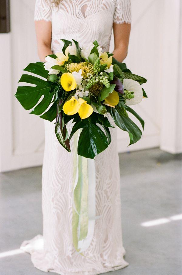 tropical wedding bouquet - photo by Krista Mason Photography http://ruffledblog.com/tropical-leaves-and-sea-glass-wedding-shoot #weddingbouquet #bouquets