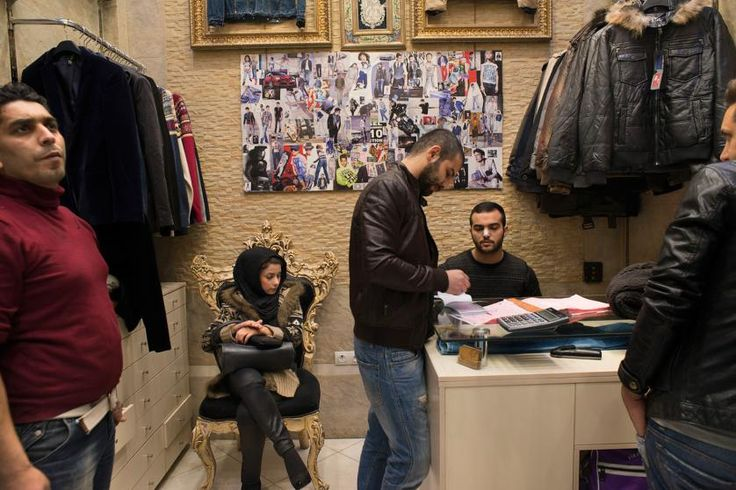 At the Grand Bazar, a clothing store sells fashion and clothing imported from Turkey, which has got more difficult and more expensive, making it hard to compete with locally made fashion goods. Tehran, Iran, Nov. 18, 2013.
