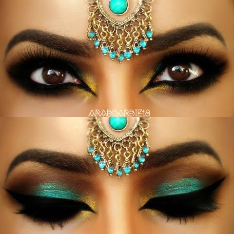 This eye makeup uses dark and teal eye shadow, accentuated by heavy black liner and false eyelashes. Try this gorgeous exotic look today. See the product list here.