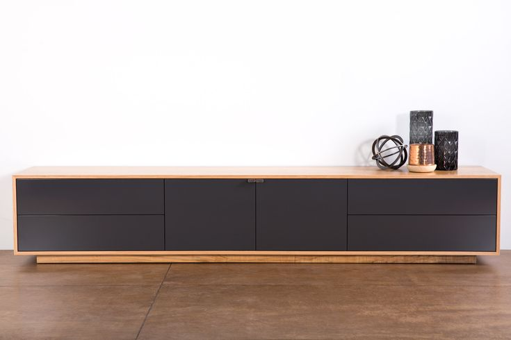 Tribeca 2400 Lowline TV Unit. Designed and manufactured here in WA. Custom made to you size and colour. Pictured in WA Marri Veneer with Monument grey doors and drawers. Features our new side mount doors for a space saving and push to open drawers.