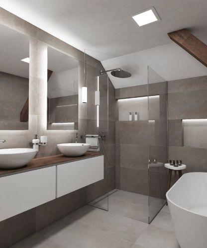 V podkrovní koupelně ATTIC stála designérka Simona před úkolem vtěsnat do necelých 7 m² dvě umyvadla, sprchový kout, solitérní vanu a ještě  poskytnout dostatek úložného prostoru, to celé navzdory šikmině a trámu.Barevný a materiálový koncept koupelny ATTIC navazuje na industriální styl celého bytu. Setkáváme se zde tak s dlažbou Tool imitující betonu v tmavě a světle šedém odstínu - Tool Grey a Tool Light Grey. Jistou vřelost, jinak minimalistickému designu, pak dodává dřevo opakující se na…
