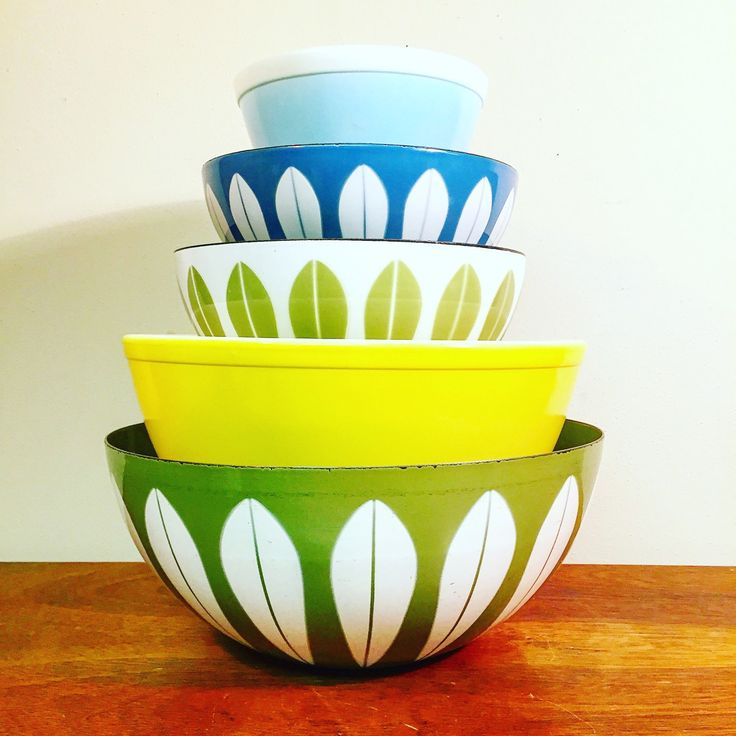Colorful mismatched vintage Pyrex and Cathrineholm bowls from HobAndNail on Etsy.
