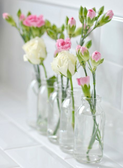bottles vases with roses + carnations
