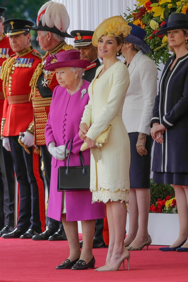 Color explosion  Letizia and Queen Elizabeth II put the touch of color to a cloudy day in London.