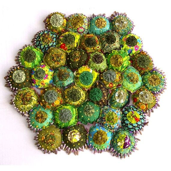 Yo-yos made into a garden of greens.  http://www.etsy.com/listing/52388859/a-yo-yo-textile-garden-greens